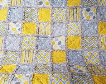 Yellow, gray and white rag quilt throw