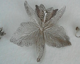 vintage silver filigree brooch and earrings set featuring orchid flower