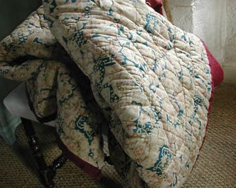 French Antique Quilt from around 1900. Entirely hand quilted Barkcloth textile. Floral design with Bordeaux Red Back. Quilted Bedspread