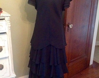 Tiered and beautifully layered black dress....fully lined...vintage....stylish