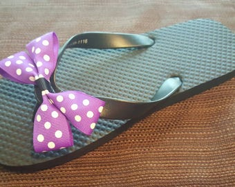 Girls purple and black flip flops