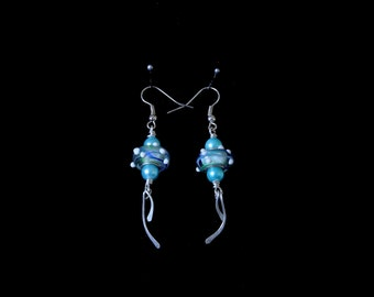 Earings. Silver plated, pale Turquoise blue Lampwork earrings, with Turquoise blue Czech glass pearls, and silver plated paddle dangles.