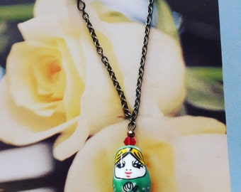 Bronze green russian doll necklace