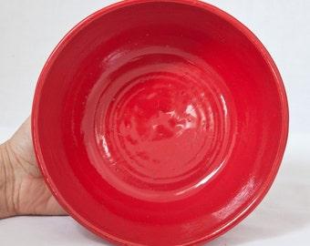 Red stoneware serving bowl