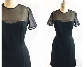 Classic LBD with sweetheart illusion sheer neckline. Size M.