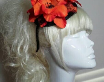 Beautiful zesty Orange flower and black lace fascinator