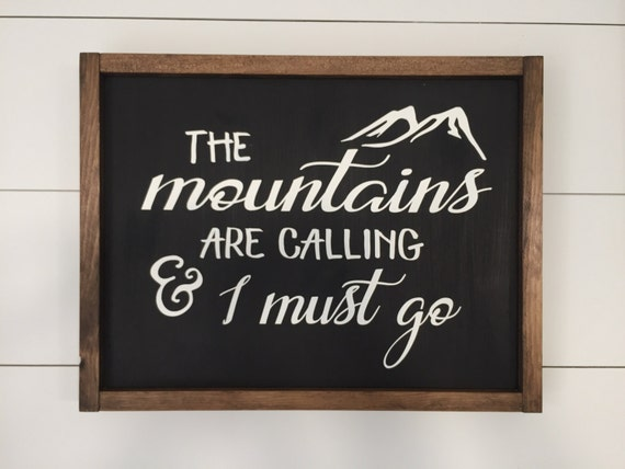 The mountains are calling and i must go framed wood sign for The mountains are calling and i must go metal sign