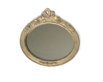 Gold Mirror with Floral Detail