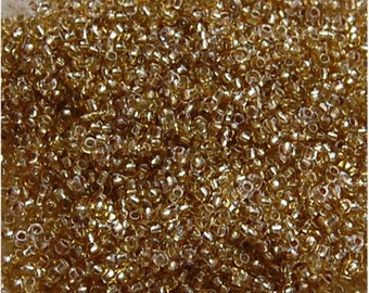 OLD STOCK Seed Beads, Size 11, Dull Gold, sold in units of approx 50 grams.