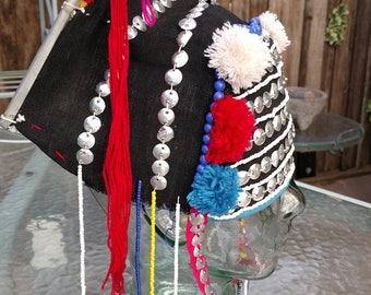 This hat looks very similar to the hill tribe of Thailand, Cov, Neeg, Kalian, Nyob