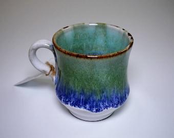 Handmade Pottery Coffee Mug in glossy blue, green and white glazes on dark clay