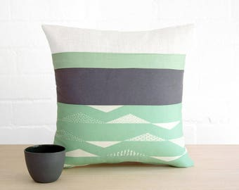 Throw pillow cushion cover in pastel mint green, slate gray grey and chalky white. Organic cotton print.
