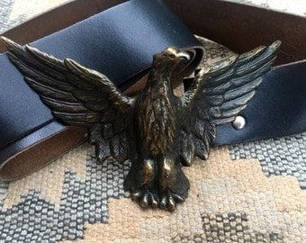 Vintage leather belt with spread eagle belt buckle.