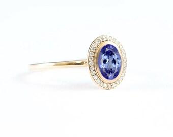 Tanzanite and diamond halo engagement ring handmade in 14 carat rose/white/yellow gold