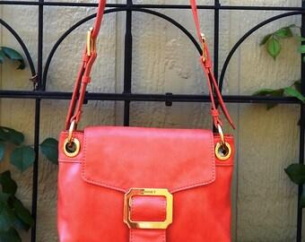 Gently used Monet coral colored faux leather shoulder bag, crossbody bag, gypsy bag, boho bag, bohemian bag