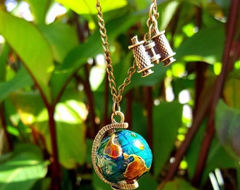 Wanderlust pendant with globe and binoculars
