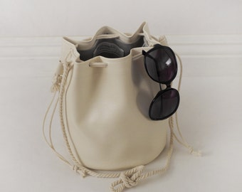 Faux leather drawstring bucket bag with cotton rope