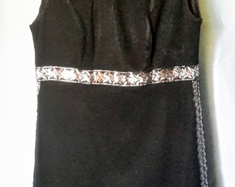 Vintage black dress with silver trim in excellent condition, size small