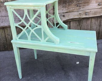 Soft green and white distressed side table