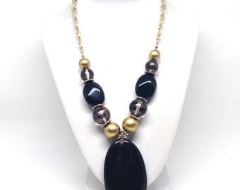 Intriguing Black Beaded Single Strand Gold Tone Estate Necklace