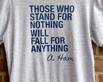 "Alexander Hamilton ""those who stand for nothing will fall for anything"" tee in raglan baseball style or short sleeved tee"