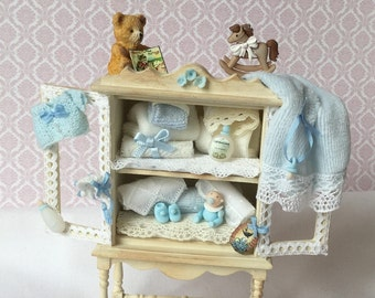 Wardrobe for baby room decorated in white and blue