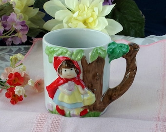 Vintage Little Red Riding Hood fairy tale cup by J.S.N.Y. Taiwan. Child's ceramic storybook mug 3D figural in bright colors.  Hand painted.