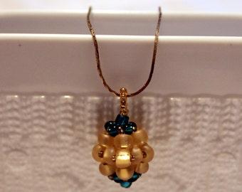 Colorful golden & blue-beaded Pendant; beadweaving, handmade, cute, elegant