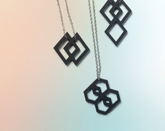 With a small heart pendant geometric black in 3 variants