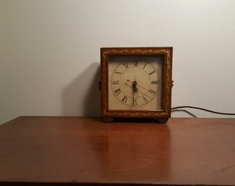 Vintage Leather-Bound Electric Clock by Howard Miller Clock Company, Vintage Howard Miller Electric Leather Clock
