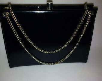 Crown Lewis_ 1970s Black Patent Leather Handbag, Gold Chain, Pop-Lock Clasp, and Three Interior Pockets, SF