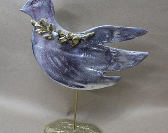 Bird with twig ,handmade , sculpture in fusing bronze and aluminium.