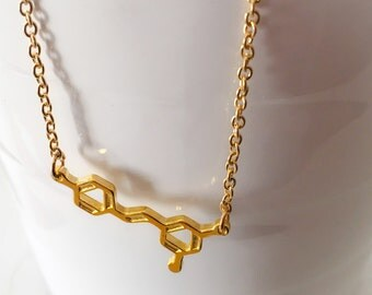 Necklace of red wine molecule in plated gold