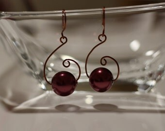 Bronze wire wrapped handmade earrings with a bead