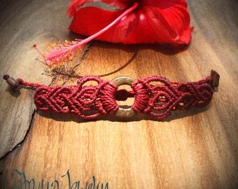 Handmade macrame bracelet with coconut shell circle.