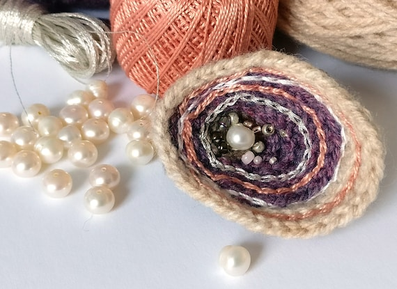 Crochet oyster shell brooch with surface embroidery, glass beads & a real pearl
