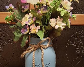 Spring Flowers In Blue Jar