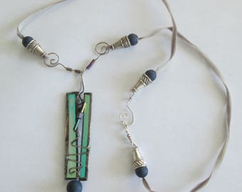 glass with copper foil wrapping with sterling silver, geodes, beads on velvet gray ribbon