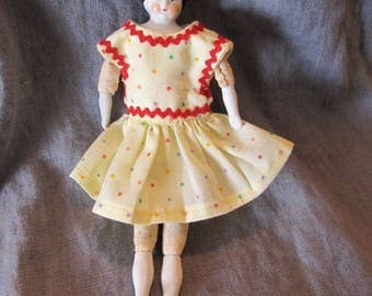 Antique German 6 inch china-head doll