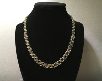 Silver and gold chainmaille necklace.