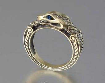 RESERVED for X. Ouroboros 14k gold ring with blue sapphire eyes