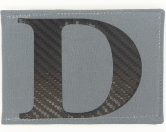 Personalised Oyster card holder, bus pass holder, travel card wallet.Monogrammed grey fabric. Black carbon fibre effect initial. Card holder