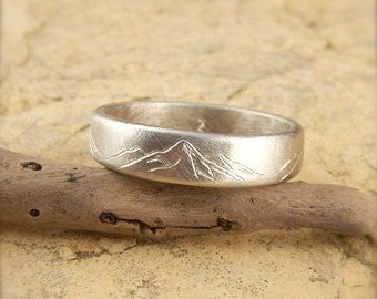 Mountain ring, solid 14k white gold band, 5 mm wide x 1.5 mm thick, engraved mountains. Ask about custom mountain ranges.