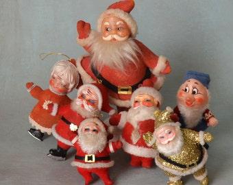Vintage Flocked Plastic Santa and Mrs. Claus Ice Skaters Helper