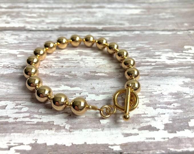 Solid 14 karat gold bead bracelet