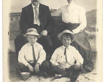Identified family on the beach  Vintage RPPC