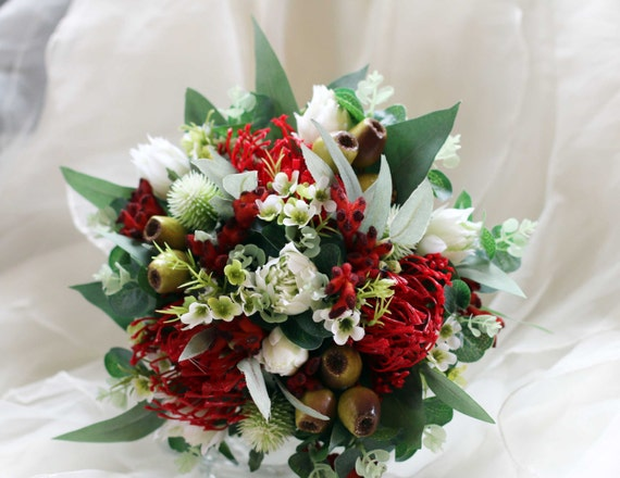 Red and white Australian native rustic bouquet. Wedding bouquet of native flowers. Banksia, waratah, waxflower and more.