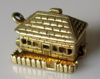 9ct Gold Nuvo Cottage Charm opens to Furniture inside