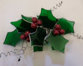 Stained glass, hanging, holly garland.