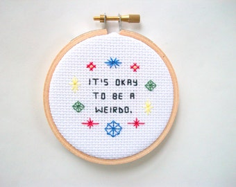 """It's okay to be a weirdo completed cross stitch -- if you're weird, it's fine, finished cross stitch from """"It's Okay"""" series"""